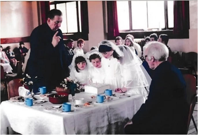 First Communion Party 9 June 1985 Fr Bell and Fr Hurley with Lucy, Yvonne, Joanna and Kathleen.